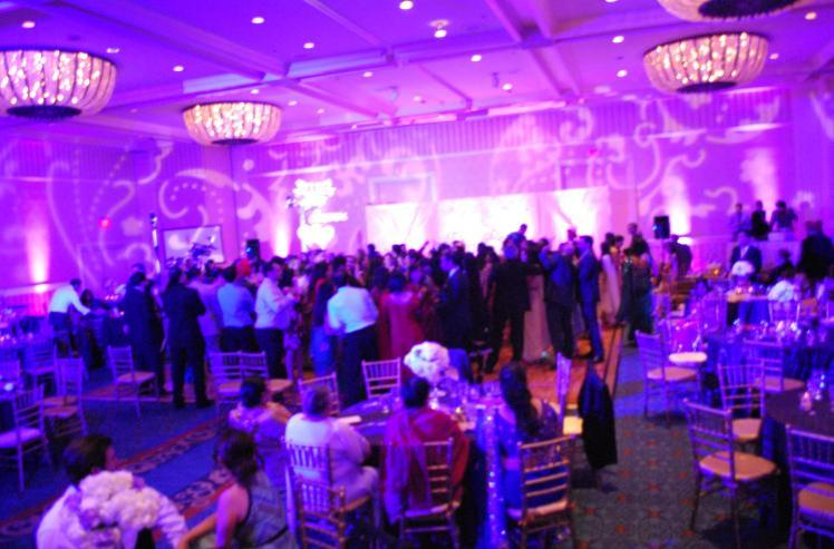 Denver's Best DJs Provides an Elegant Pink Purple and Blue DJ Lighting Effect at a Wedding Reception in Denver Colorado