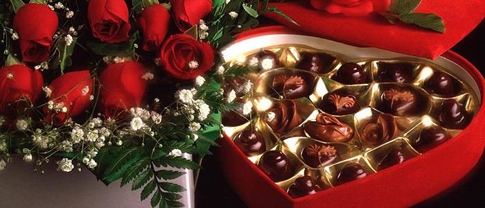 Romantic Valentines day gift Chocolates, candles and Roses