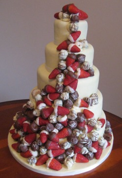 Amazing Wedding Cake With Chocolate Dipped Strawberries running down the entire cake
