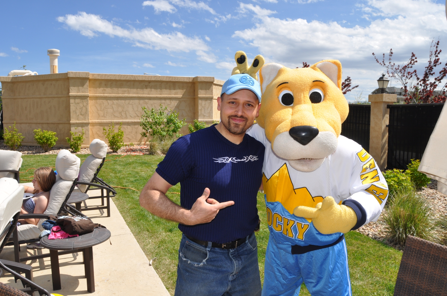 DJ Emir of Denver's Best DJs with Rocky The Denver Nuggets Basketball Team Mascot at a Denver Pool Party