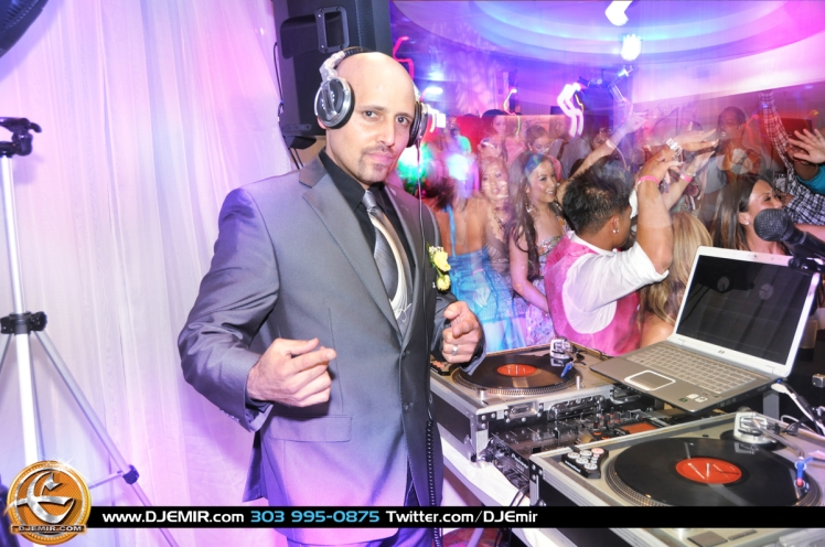DJ Emir of Denver's Best DJs Deejaying a Wedding in Denver Colorado with Technics Turntables suit tie hands in the air party vibe DJ lighting laptop dj mixer