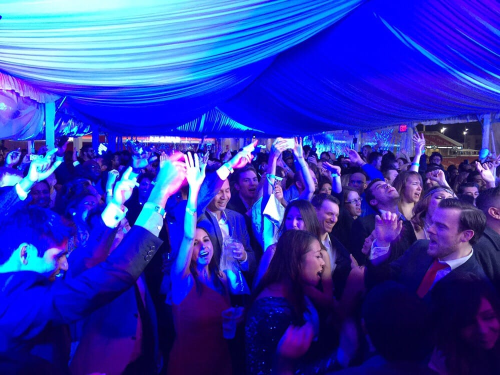 Denver corporate party djs under tent blue dj lighting people having fun